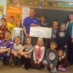 Nickels for Nick and 3rd Grade Class Sts. Peter & Paul School (Granddaughter Olivia standing next to Nick)